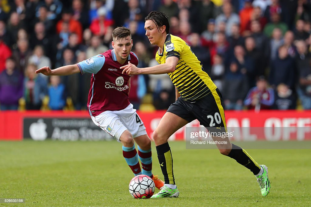 Steve Berghuis of Watford and Kevin Toner of Aston Villa compete for the ball during the Barclays Premier League match between Watford and Aston Villa at Vicarage Road on April 30, 2016 in Watford, England.