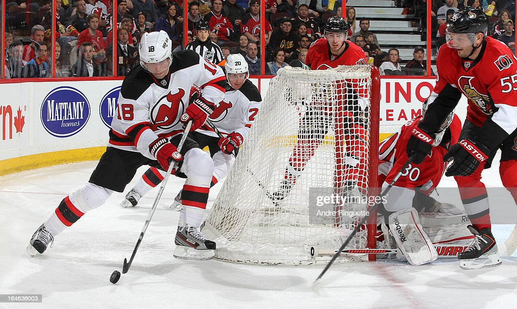 Steve Bernier #18 and Ryan Carter #20 of the New Jersey Devils control the puck behind the net against Patrick Wiercioch #46 and Sergei Gonchar #55 of the Ottawa Senators on March 25, 2013 at Scotiabank Place in Ottawa, Ontario, Canada.