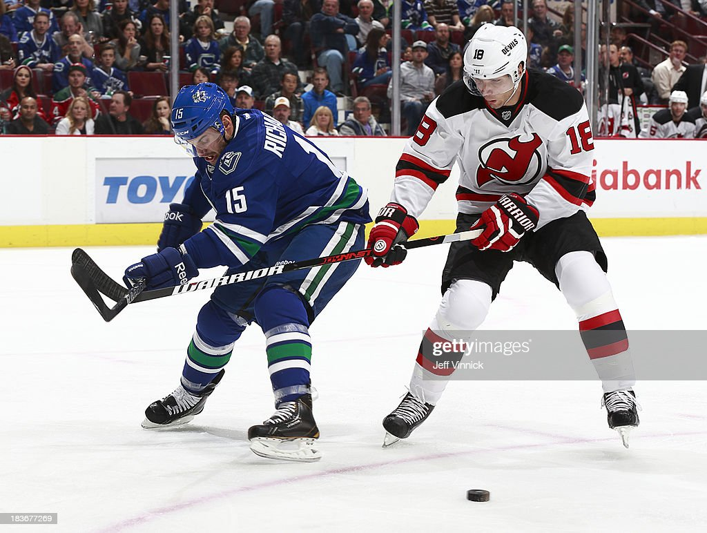 <a gi-track='captionPersonalityLinkClicked' href=/galleries/search?phrase=Steve+Bernier&family=editorial&specificpeople=557040 ng-click='$event.stopPropagation()'>Steve Bernier</a> #18 of the New Jersey Devils and <a gi-track='captionPersonalityLinkClicked' href=/galleries/search?phrase=Brad+Richardson&family=editorial&specificpeople=638058 ng-click='$event.stopPropagation()'>Brad Richardson</a> #15 of the Vancouver Canucks battle for the puck during their NHL game at Rogers Arena on October 8, 2013 in Vancouver, British Columbia, Canada. Vancouver won 3-2.