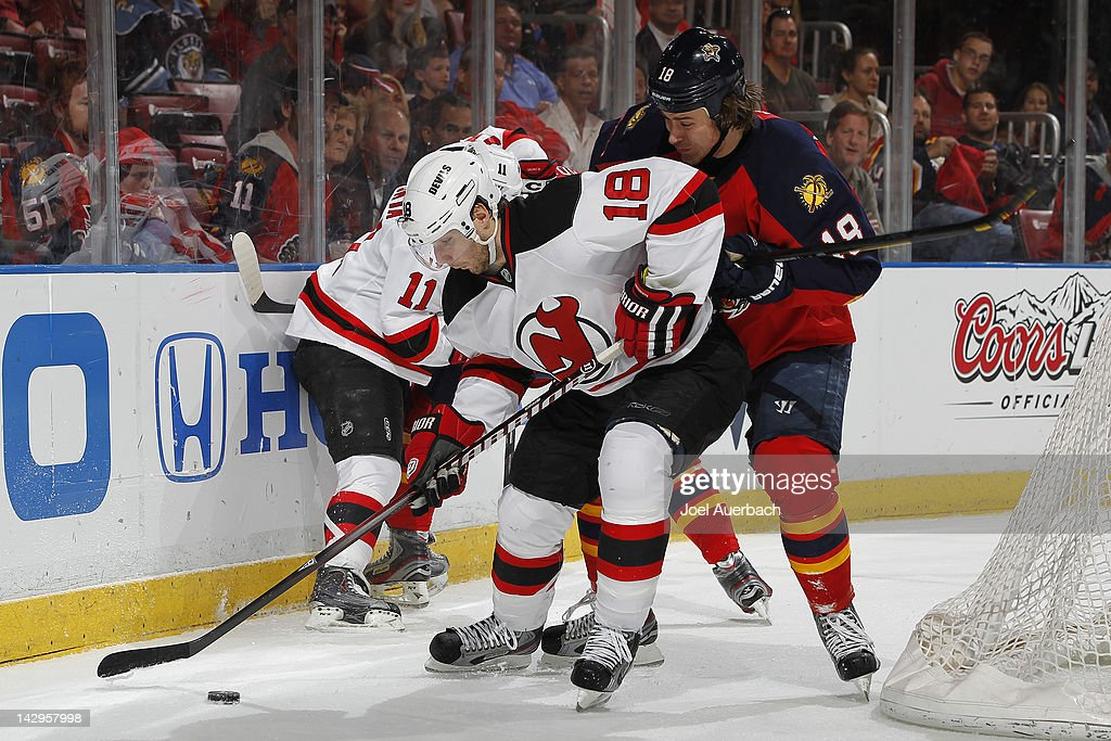 <a gi-track='captionPersonalityLinkClicked' href=/galleries/search?phrase=Steve+Bernier&family=editorial&specificpeople=557040 ng-click='$event.stopPropagation()'>Steve Bernier</a> #18 of the New Jersey Devils attempts to control the puck while being defended against by Shawn Matthias #18 of the Florida Panthers in Game Two of the Eastern Conference Quarterfinals during the 2012 NHL Stanley Cup Playoffs at the BankAtlantic Center on April 15, 2012 in Sunrise, Florida. The Panthers defeated the Devils 4-2.