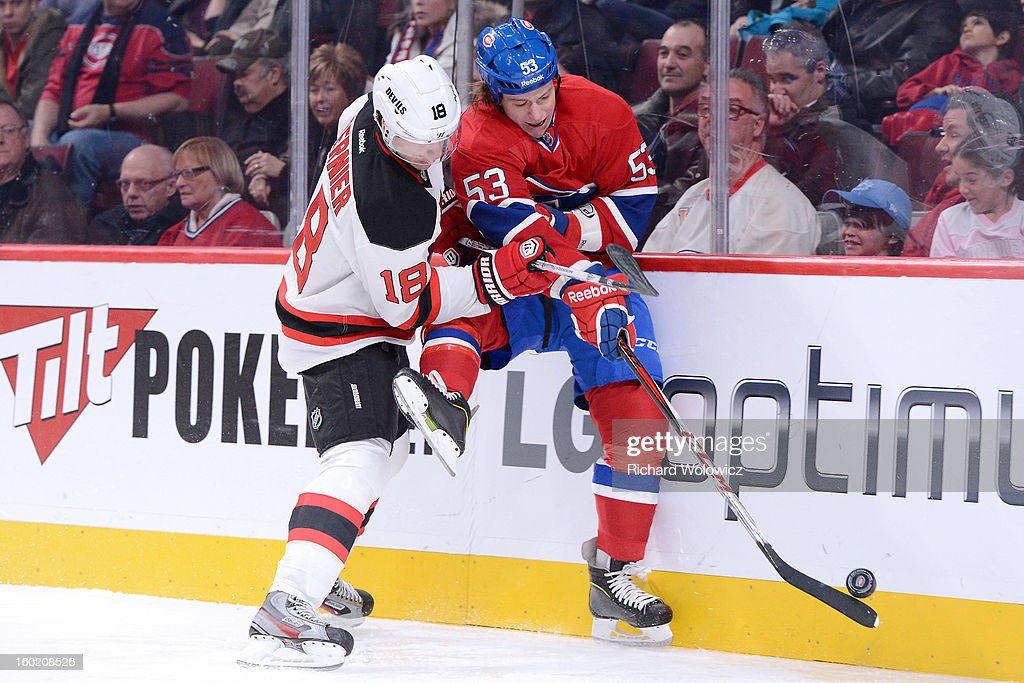 Steve Bernier #18 of the New Jersey Devils body checks Ryan White during the NHL game at the Bell Centre on January 27, 2013 in Montreal, Quebec, Canada. The Canadiens defeated the Devils 4-3 in overtime.