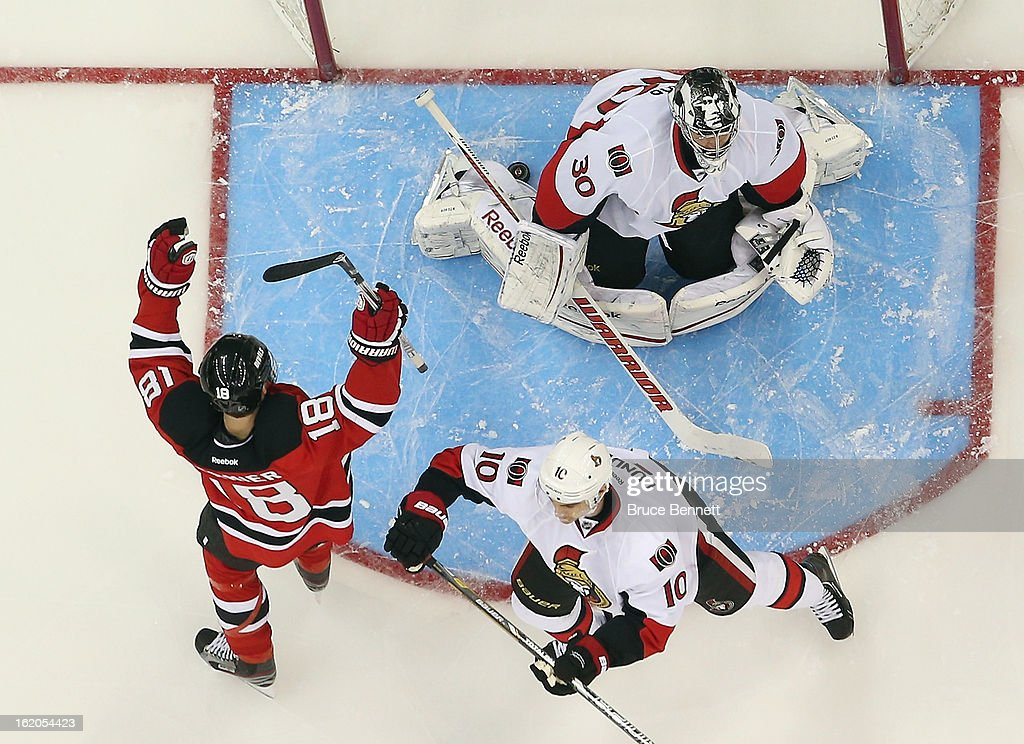 <a gi-track='captionPersonalityLinkClicked' href=/galleries/search?phrase=Steve+Bernier&family=editorial&specificpeople=557040 ng-click='$event.stopPropagation()'>Steve Bernier</a> #18 of the New Jersey Devils celebrates a first period goal by Stephen Gionta #11 (not shown) against <a gi-track='captionPersonalityLinkClicked' href=/galleries/search?phrase=Ben+Bishop&family=editorial&specificpeople=700137 ng-click='$event.stopPropagation()'>Ben Bishop</a> #30 of the Ottawa Senators at the Prudential Center on February 18, 2013 in Newark, New Jersey. The Senators defeated the Devils 2-1 in the shootout.