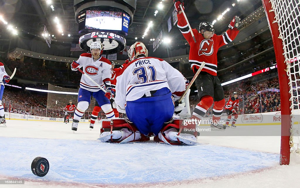 <a gi-track='captionPersonalityLinkClicked' href=/galleries/search?phrase=Steve+Bernier&family=editorial&specificpeople=557040 ng-click='$event.stopPropagation()'>Steve Bernier</a> #18 of the New Jersey Devils celebrates a goal by Peter Harrold #10 (not shown) at 3:54 of the second period against <a gi-track='captionPersonalityLinkClicked' href=/galleries/search?phrase=Carey+Price&family=editorial&specificpeople=2222083 ng-click='$event.stopPropagation()'>Carey Price</a> #31 of the Montreal Canadiens at the Prudential Center on March 16, 2013 in Newark, New Jersey. The Canadiens defeated the Devils 2-1.