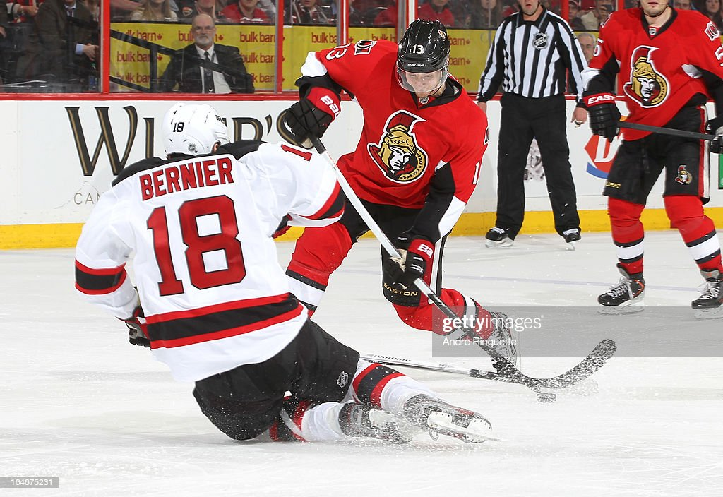 Steve Bernier #18 of the New Jersey Devils dives to block a slapshot by Peter Regin #13 of the Ottawa Senators on March 25, 2013 at Scotiabank Place in Ottawa, Ontario, Canada.