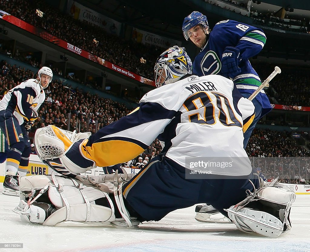 <a gi-track='captionPersonalityLinkClicked' href=/galleries/search?phrase=Steve+Bernier&family=editorial&specificpeople=557040 ng-click='$event.stopPropagation()'>Steve Bernier</a> #18 of the Vancouver Canucks is stopped in close by <a gi-track='captionPersonalityLinkClicked' href=/galleries/search?phrase=Ryan+Miller+-+Ice+Hockey+Player&family=editorial&specificpeople=206960 ng-click='$event.stopPropagation()'>Ryan Miller</a> #30 of the Buffalo Sabres as <a gi-track='captionPersonalityLinkClicked' href=/galleries/search?phrase=Henrik+Tallinder&family=editorial&specificpeople=204661 ng-click='$event.stopPropagation()'>Henrik Tallinder</a> #10 looks on during their game at General Motors Place on January 25, 2010 in Vancouver, British Columbia, Canada.
