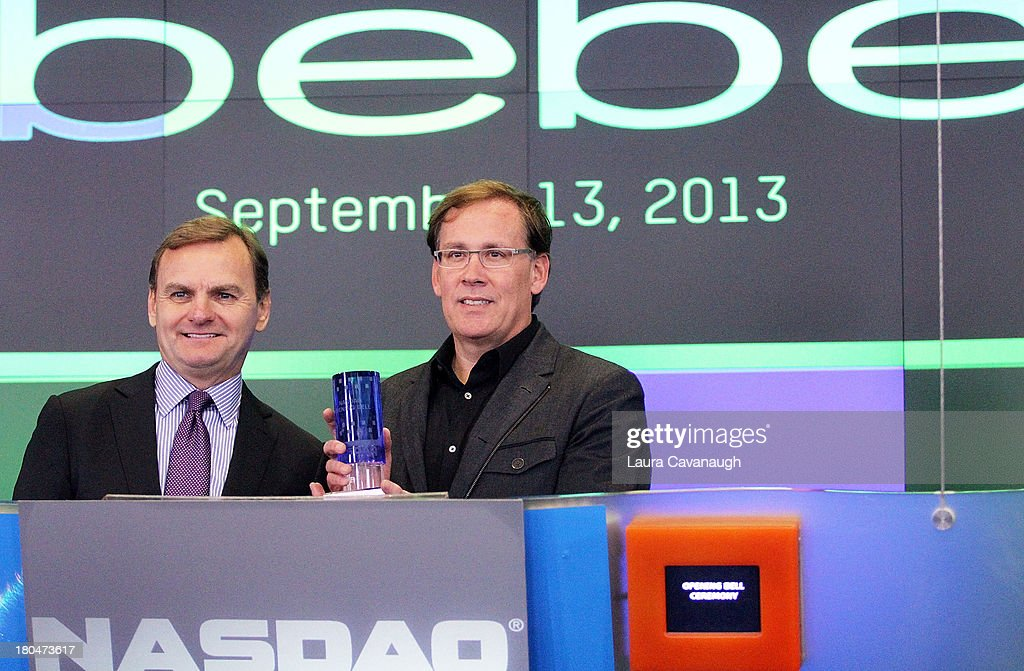 Steve Birkhold, CEO of Bebe Stores, Inc. and Bruce Aust rings the opening bell at NASDAQ MarketSite on September 13, 2013 in New York City.