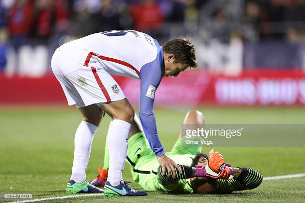 Steve Birnbaum assists teammate Tim Howard during the match between USA and Mexico as part of FIFA 2018 World Cup Qualifiers at MAPFRE Stadium on...