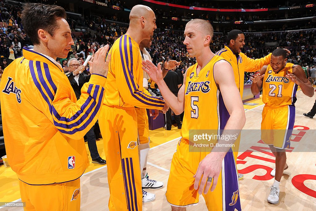 Steve Blake #5 and Steve Nash #10 of the Los Angeles Lakers celebrate after their team's victory against the Boston Celtics at Staples Center on February 20, 2013 in Los Angeles, California.