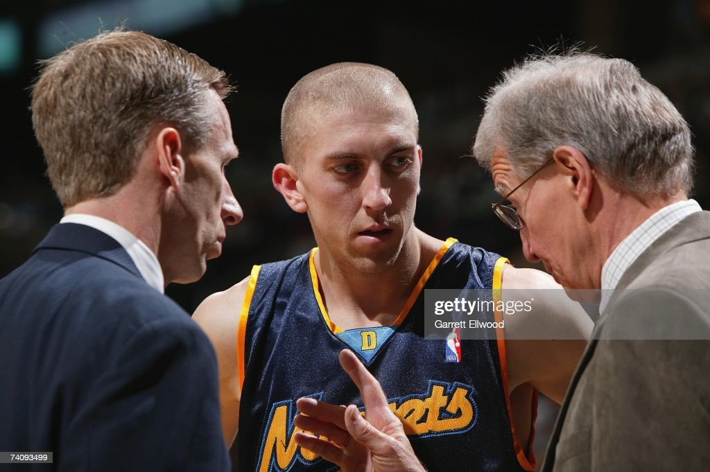Steve Blake #25, center, talks to assistant coaches Mike Dunlap, left, and Tim Grgurich, right, of the Denver Nuggets in Game Two of the Western Conference Quarterfinals against the San Antonio Spurs during the 2007 NBA Playoffs at AT&T Center on April 25, 2007 in San Antonio, Texas. The Spurs won 97-88.