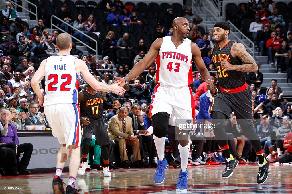Steve Blake high fives teammate Anthony Tolliver of the Detroit Pistons during the game against the Atlanta Hawks on March 16 2016 at The Palace of...