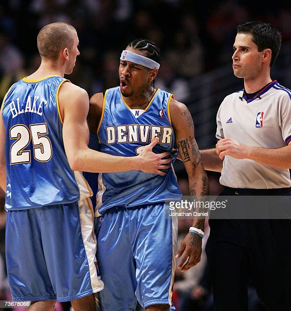 Steve Blake of the Denver Nuggets restrains teammate Allen Iverson as he complains about a call from referee David Guthrie during a game against the...