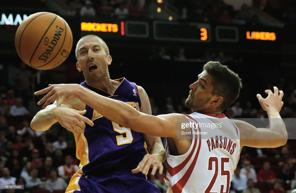 <a gi-track='captionPersonalityLinkClicked' href=/galleries/search?phrase=Steve+Blake+-+Basketball+Player&family=editorial&specificpeople=204474 ng-click='$event.stopPropagation()'>Steve Blake</a> #5 of the Los Angeles Lakers battles for the ball with <a gi-track='captionPersonalityLinkClicked' href=/galleries/search?phrase=Chandler+Parsons&family=editorial&specificpeople=4249869 ng-click='$event.stopPropagation()'>Chandler Parsons</a> #25 of the Houston Rockets during the game at Toyota Center on November 7, 2013 in Houston, Texas.