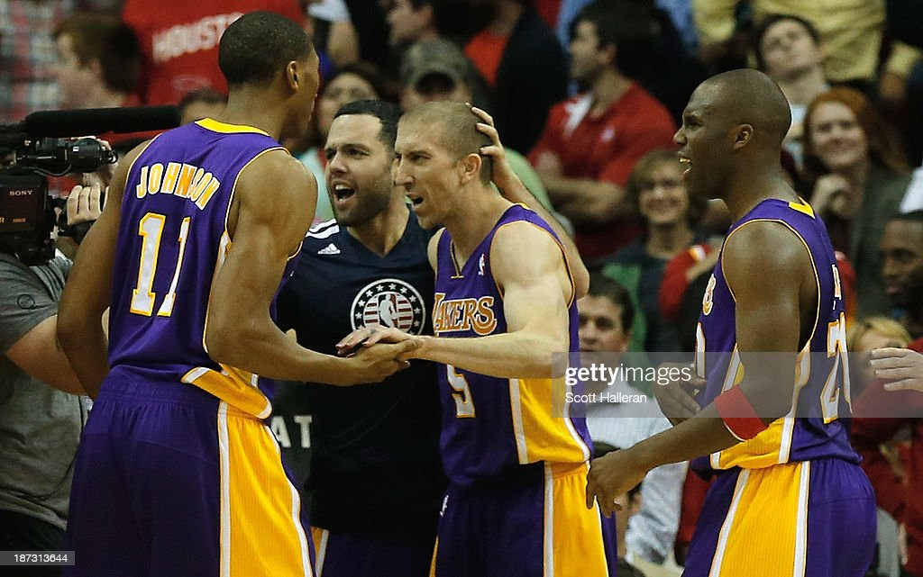 <a gi-track='captionPersonalityLinkClicked' href=/galleries/search?phrase=Steve+Blake+-+Basketball+Player&family=editorial&specificpeople=204474 ng-click='$event.stopPropagation()'>Steve Blake</a> #5 of the Los Angeles Lakers celebrates with his teammates after his game-winning three point shot en route to a 99-98 defeat of the Houston Rockets during the game at Toyota Center on November 7, 2013 in Houston, Texas.