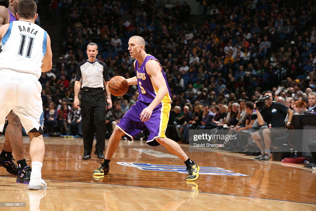 Steve Blake #5 of the Los Angeles Lakers crosses over his dribble against the Minnesota Timberwolves during the game on February 1, 2013 at Target Center in Minneapolis, Minnesota.