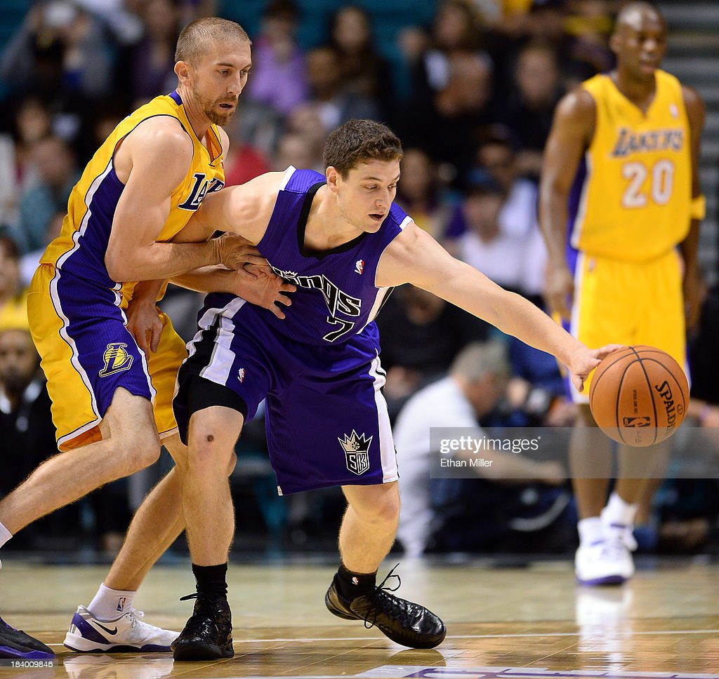 <a gi-track='captionPersonalityLinkClicked' href=/galleries/search?phrase=Steve+Blake&family=editorial&specificpeople=204474 ng-click='$event.stopPropagation()'>Steve Blake</a> #5 of the Los Angeles Lakers defends against <a gi-track='captionPersonalityLinkClicked' href=/galleries/search?phrase=Jimmer+Fredette&family=editorial&specificpeople=5020564 ng-click='$event.stopPropagation()'>Jimmer Fredette</a> #7 of the Sacramento Kings during their preseason game at the MGM Grand Garden Arena on October 10, 2013 in Las Vegas, Nevada. Sacramento won 104-86.