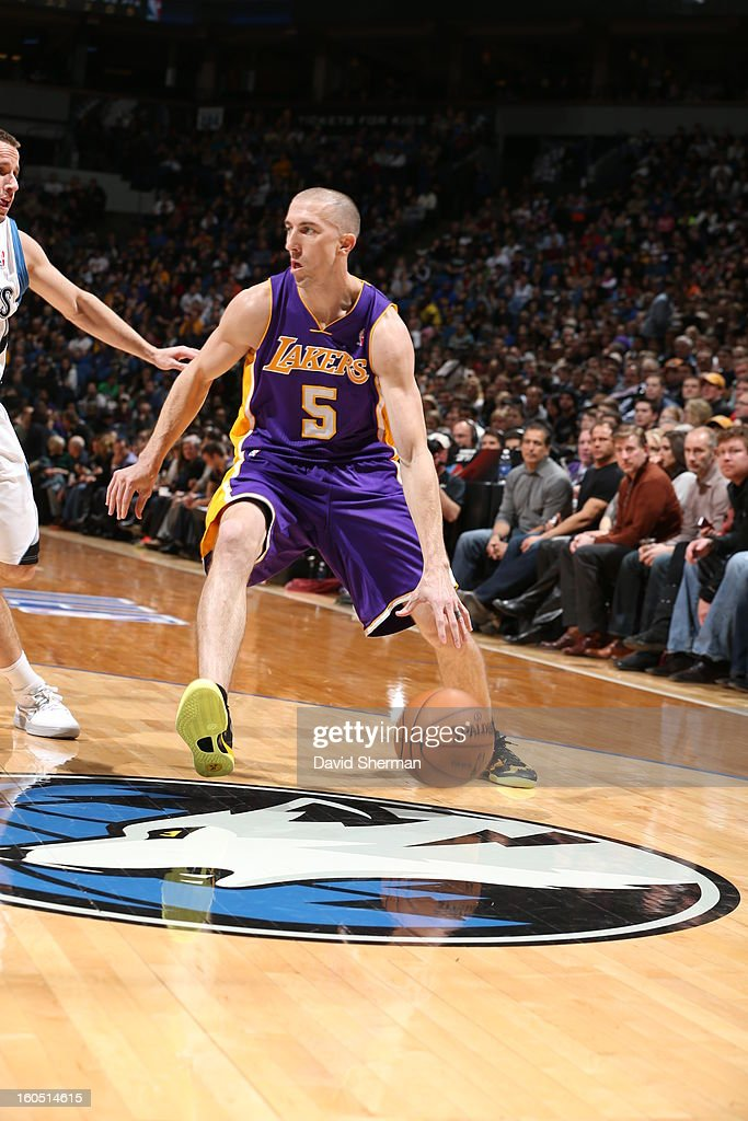 Steve Blake #5 of the Los Angeles Lakers dribbles the ball against the Minnesota Timberwolves during the game on February 1, 2013 at Target Center in Minneapolis, Minnesota.