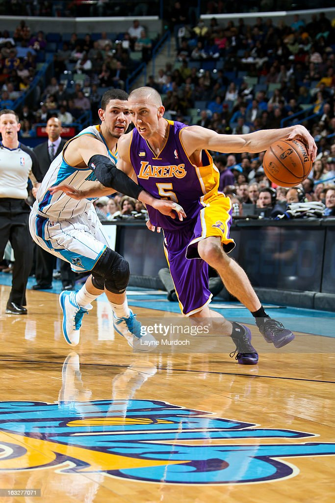 Steve Blake #5 of the Los Angeles Lakers drives against Austin Rivers #25 of the New Orleans Hornets on March 6, 2013 at the New Orleans Arena in New Orleans, Louisiana.