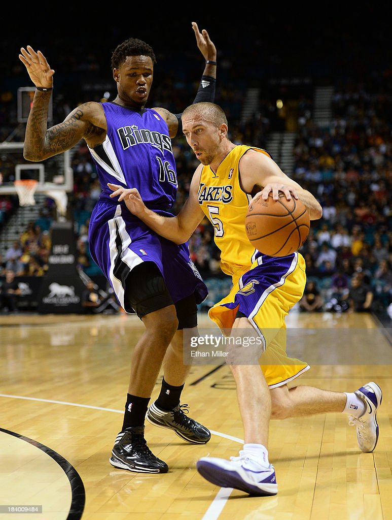<a gi-track='captionPersonalityLinkClicked' href=/galleries/search?phrase=Steve+Blake+-+Basketball+Player&family=editorial&specificpeople=204474 ng-click='$event.stopPropagation()'>Steve Blake</a> #5 of the Los Angeles Lakers drives against <a gi-track='captionPersonalityLinkClicked' href=/galleries/search?phrase=Ben+McLemore&family=editorial&specificpeople=9966388 ng-click='$event.stopPropagation()'>Ben McLemore</a> #16 of the Sacramento Kings during their preseason game at the MGM Grand Garden Arena on October 10, 2013 in Las Vegas, Nevada. Sacramento won 104-86.
