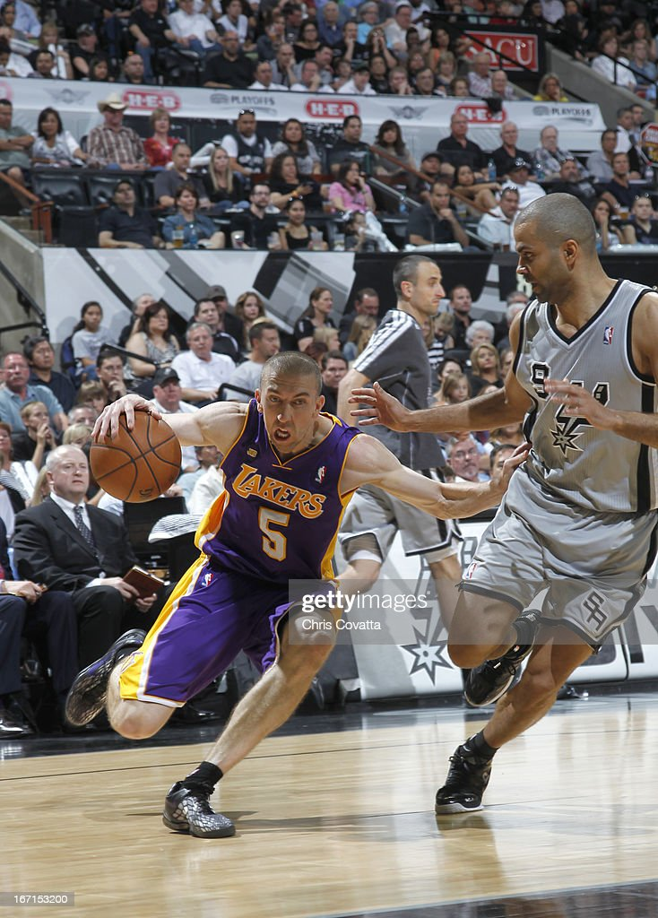 Steve Blake #5 of the Los Angeles Lakers drives against Tony Parker #9 of the San Antonio Spurs during the Game One of the Western Conference Quarterfinals between the Los Angeles Lakers and the San Antonio Spurs on April 21, 2013 at the AT&T Center in San Antonio, Texas.