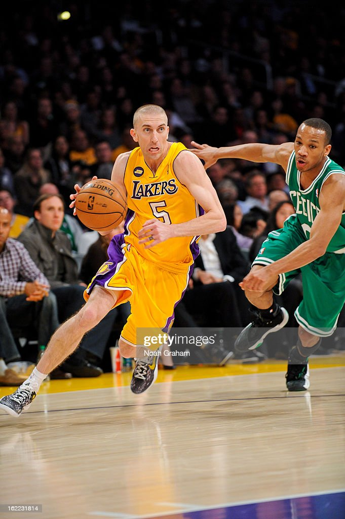 Steve Blake #5 of the Los Angeles Lakers drives ahead of Avery Bradley #0 of the Boston Celtics at Staples Center on February 20, 2013 in Los Angeles, California.