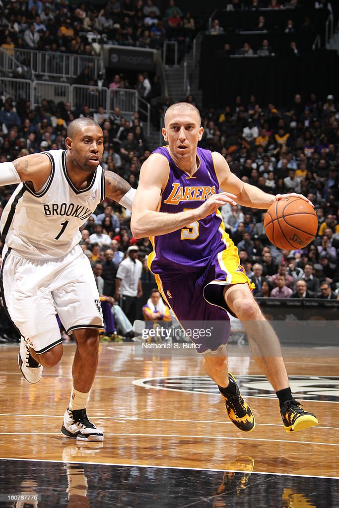 Steve Blake #5 of the Los Angeles Lakers drives to the basket against C.J. Watson #1 of the Brooklyn Nets on February 5, 2013 at the Barclays Center in the Brooklyn borough of New York City.