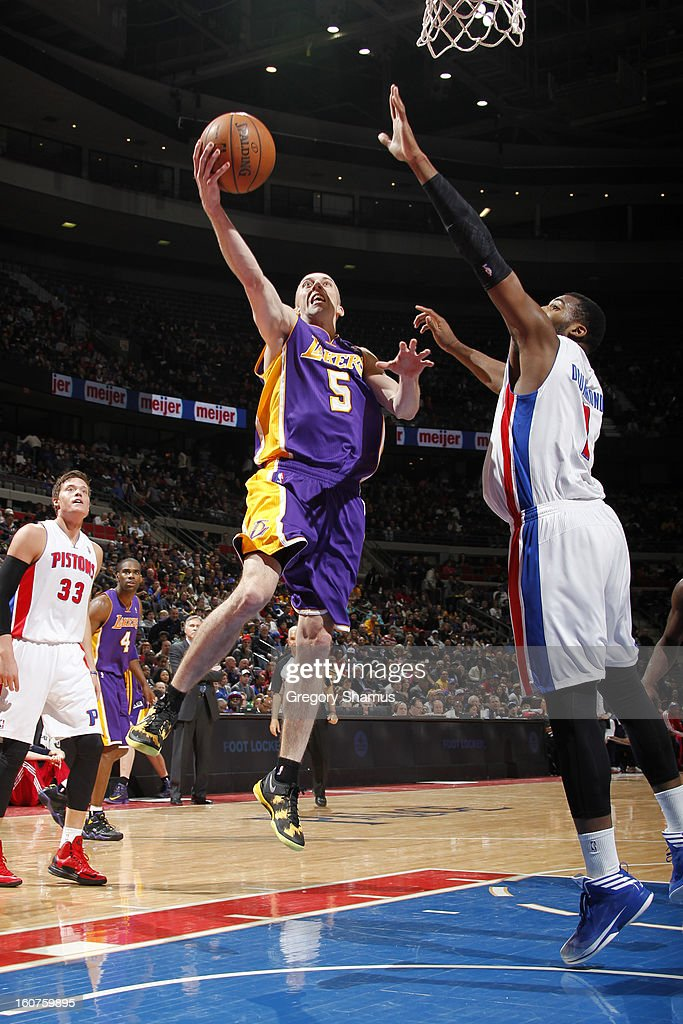Steve Blake #5 of the Los Angeles Lakers drives to the basket against Andre Drummond #1 of the Detroit Pistons on February 3, 2013 at The Palace of Auburn Hills in Auburn Hills, Michigan.