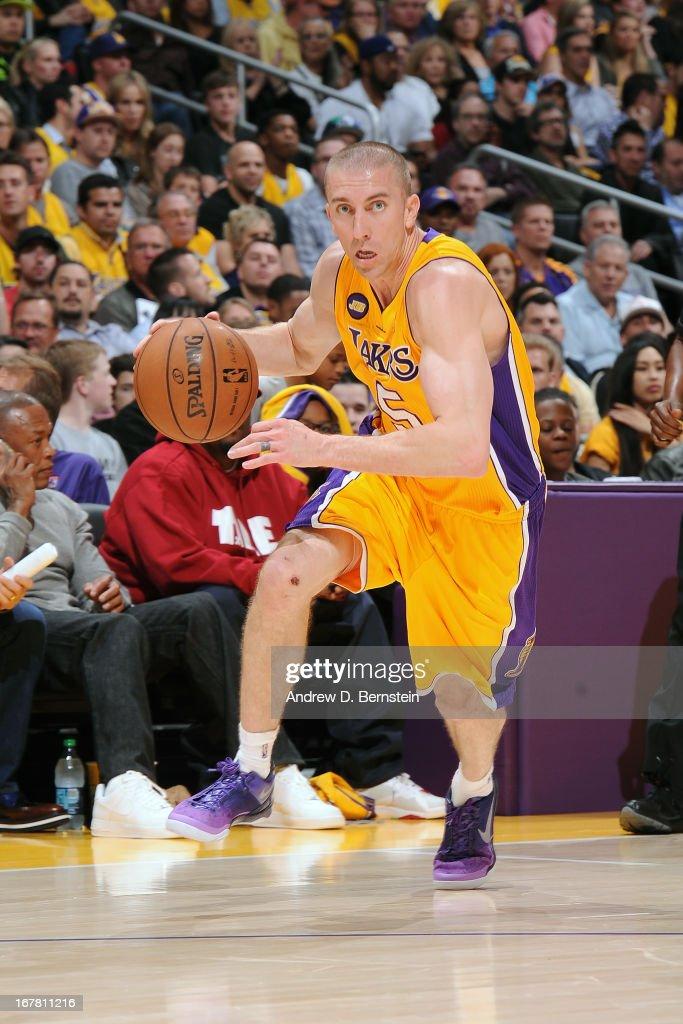 <a gi-track='captionPersonalityLinkClicked' href=/galleries/search?phrase=Steve+Blake&family=editorial&specificpeople=204474 ng-click='$event.stopPropagation()'>Steve Blake</a> #5 of the Los Angeles Lakers drives to the basket against the Dallas Mavericks at Staples Center on April 2, 2013 in Los Angeles, California.