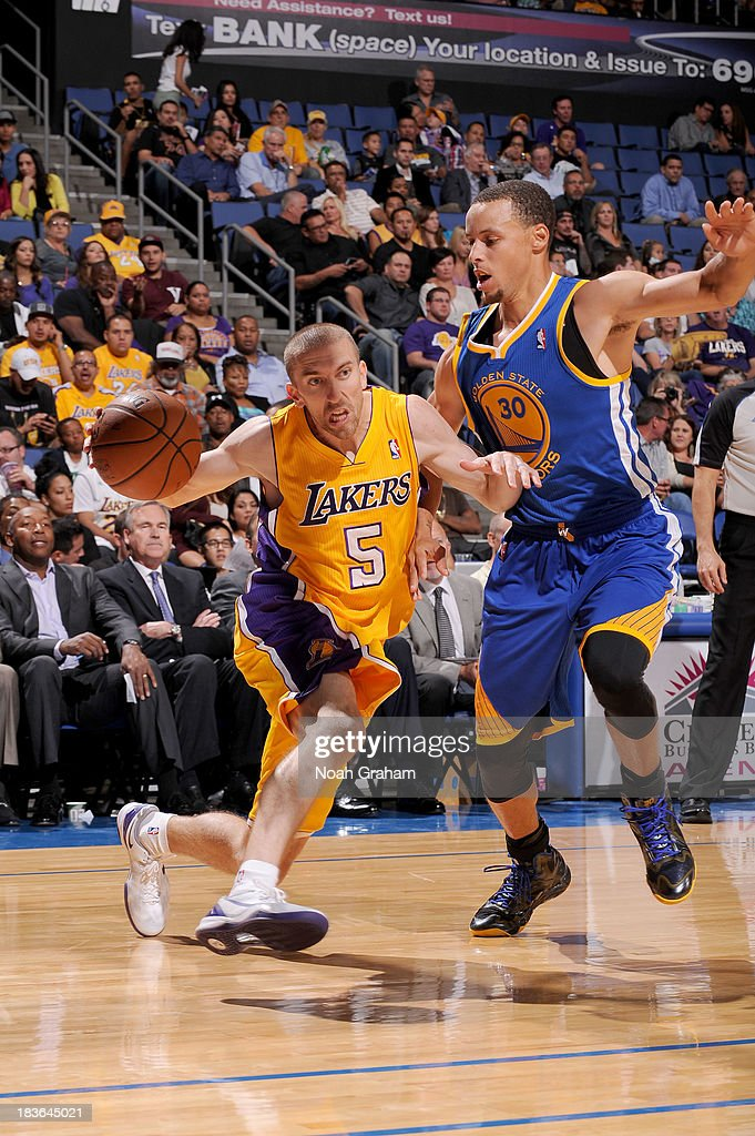 <a gi-track='captionPersonalityLinkClicked' href=/galleries/search?phrase=Steve+Blake+-+Basketball+Player&family=editorial&specificpeople=204474 ng-click='$event.stopPropagation()'>Steve Blake</a> #5 of the Los Angeles Lakers drives to the basket against Stephen Curry #30 of the Golden State Warriors at Citizens Business Bank Arena on October 5, 2013 in Ontario, California.