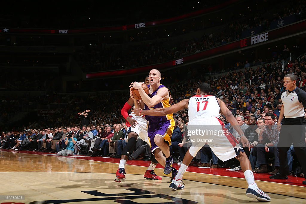 <a gi-track='captionPersonalityLinkClicked' href=/galleries/search?phrase=Steve+Blake&family=editorial&specificpeople=204474 ng-click='$event.stopPropagation()'>Steve Blake</a> #5 of the Los Angeles Lakers drives to the basket against the Washington Wizards during the game at the Verizon Center on November 26, 2013 in Washington, DC.