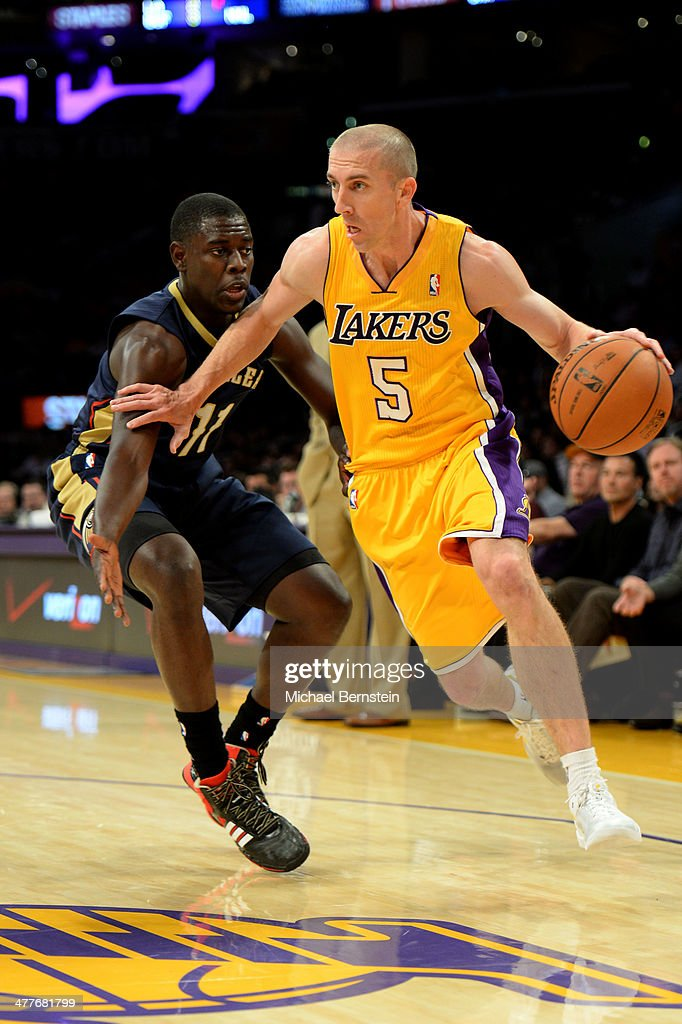 <a gi-track='captionPersonalityLinkClicked' href=/galleries/search?phrase=Steve+Blake&family=editorial&specificpeople=204474 ng-click='$event.stopPropagation()'>Steve Blake</a> #5 of the Los Angeles Lakers drives to the basket against the New Orleans Pelicans at Staples Center on November 12, 2013 in Los Angeles, California.