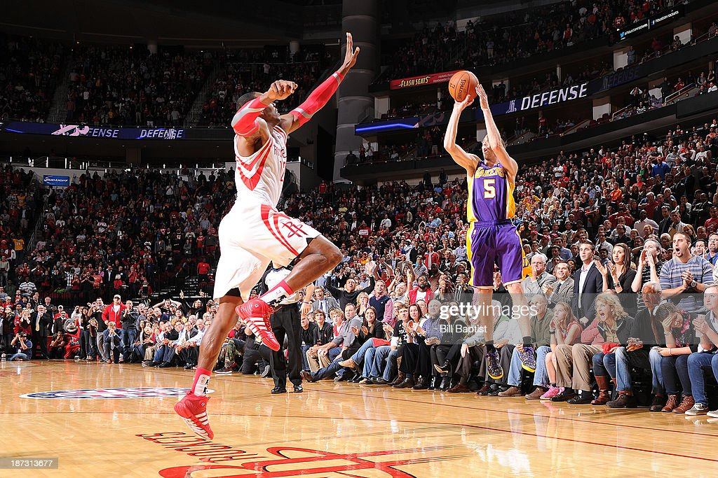 <a gi-track='captionPersonalityLinkClicked' href=/galleries/search?phrase=Steve+Blake+-+Basketball+Player&family=editorial&specificpeople=204474 ng-click='$event.stopPropagation()'>Steve Blake</a> #5 of the Los Angeles Lakers hits the game winning 3 pointer against the Houston Rockets on November 7, 2013 at the Toyota Center in Houston, Texas.