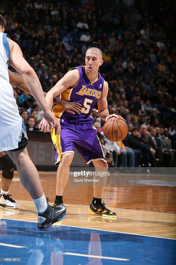 Steve Blake #5 of the Los Angeles Lakers looks down low to pass the ball against the Minnesota Timberwolves during the game on February 1, 2013 at Target Center in Minneapolis, Minnesota.