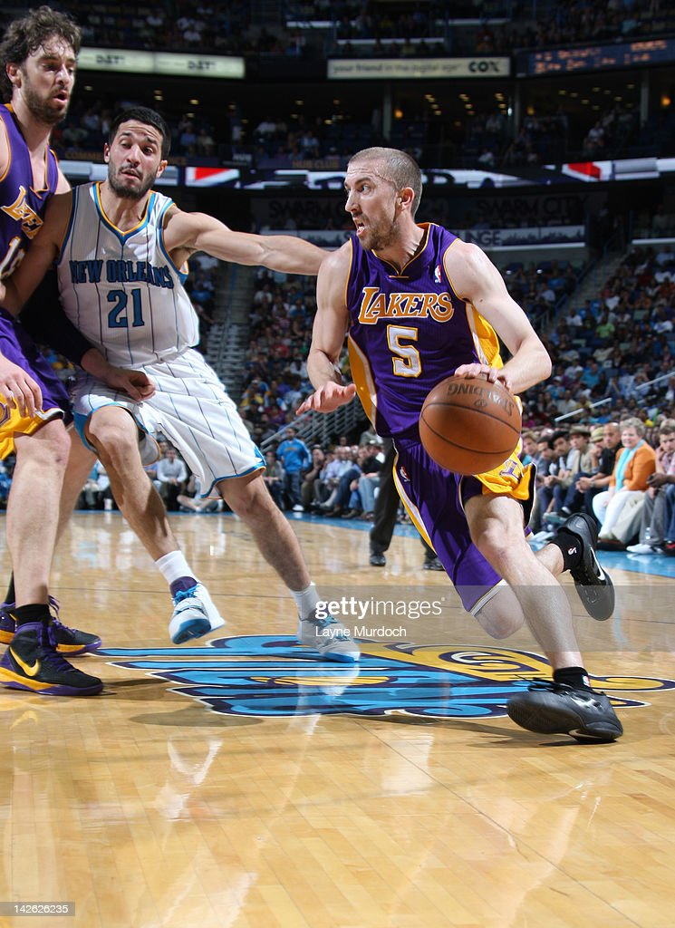 <a gi-track='captionPersonalityLinkClicked' href=/galleries/search?phrase=Steve+Blake&family=editorial&specificpeople=204474 ng-click='$event.stopPropagation()'>Steve Blake</a> #5 of the Los Angeles Lakers moves the ball against <a gi-track='captionPersonalityLinkClicked' href=/galleries/search?phrase=Greivis+Vasquez&family=editorial&specificpeople=4066977 ng-click='$event.stopPropagation()'>Greivis Vasquez</a> #21 of the New Orleans Hornets on April 9, 2012 at the New Orleans Arena in New Orleans, Louisiana.