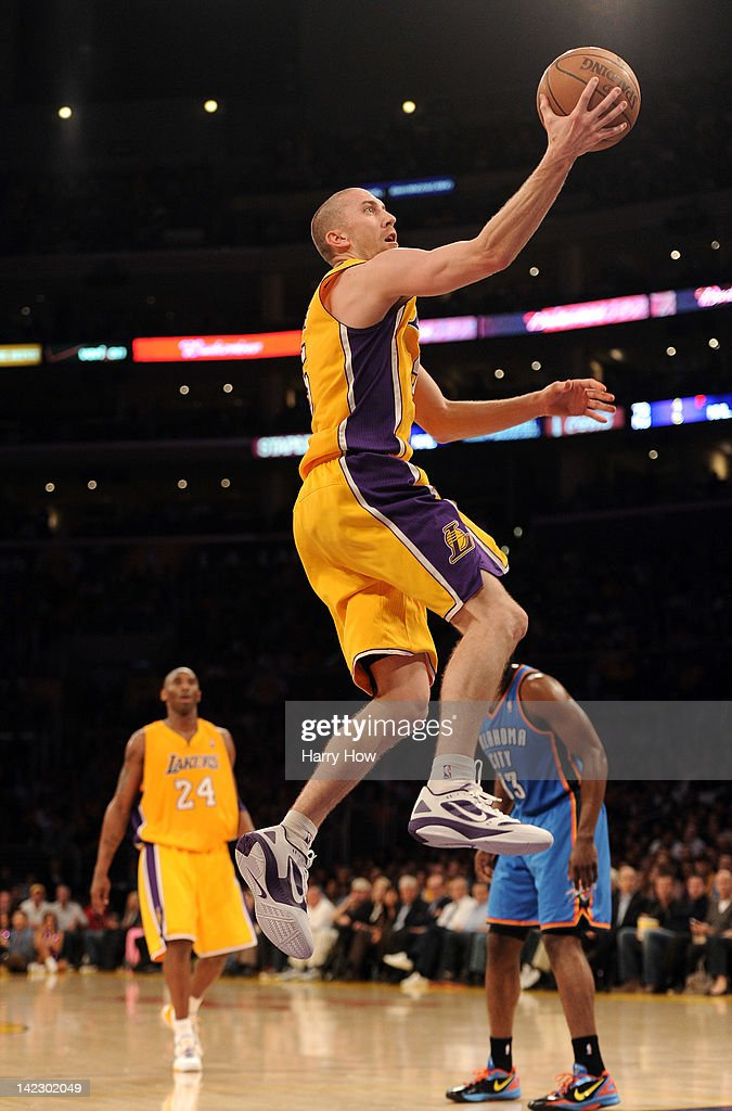 <a gi-track='captionPersonalityLinkClicked' href=/galleries/search?phrase=Steve+Blake+-+Basketball+Player&family=editorial&specificpeople=204474 ng-click='$event.stopPropagation()'>Steve Blake</a> #5 of the Los Angeles Lakers scores on a layup against the Oklahoma City Thunder at Staples Center on March 29, 2012 in Los Angeles, California.