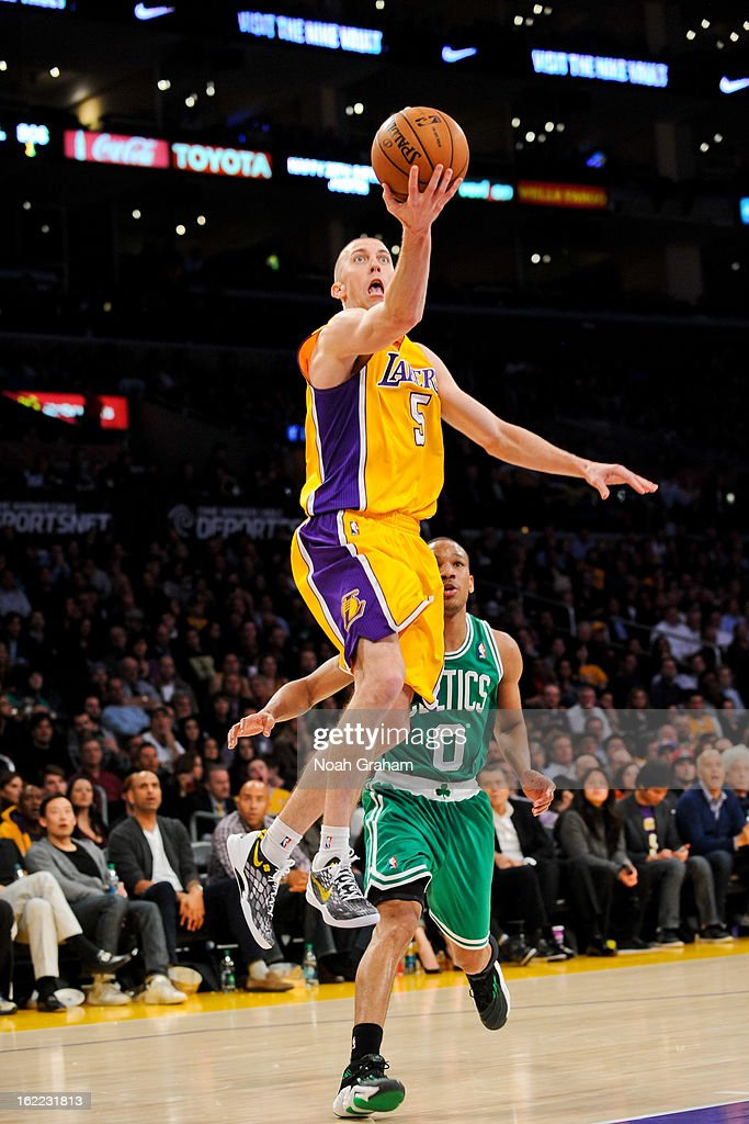 Steve Blake #5 of the Los Angeles Lakers shoots a layup ahead of Avery Bradley #0 of the Boston Celtics at Staples Center on February 20, 2013 in Los Angeles, California.