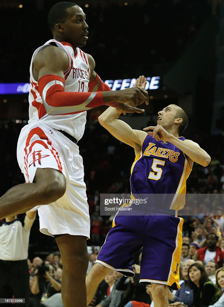 <a gi-track='captionPersonalityLinkClicked' href=/galleries/search?phrase=Steve+Blake+-+Basketball+Player&family=editorial&specificpeople=204474 ng-click='$event.stopPropagation()'>Steve Blake</a> #5 of the Los Angeles Lakers watches his game-winning three point shot over <a gi-track='captionPersonalityLinkClicked' href=/galleries/search?phrase=Dwight+Howard&family=editorial&specificpeople=201570 ng-click='$event.stopPropagation()'>Dwight Howard</a> #12 of the Houston Rockets during the game at Toyota Center on November 7, 2013 in Houston, Texas.