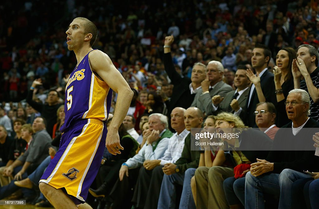 <a gi-track='captionPersonalityLinkClicked' href=/galleries/search?phrase=Steve+Blake+-+Basketball+Player&family=editorial&specificpeople=204474 ng-click='$event.stopPropagation()'>Steve Blake</a> #5 of the Los Angeles Lakers watches his game-winning three point shot against the Houston Rockets during the game at Toyota Center on November 7, 2013 in Houston, Texas.