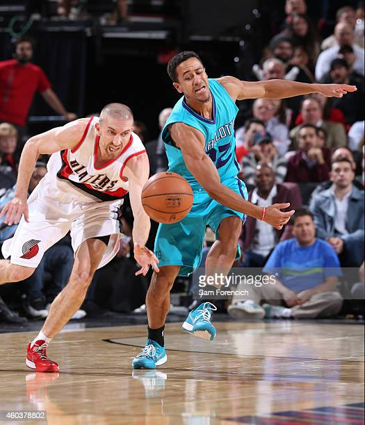 Steve Blake of the Portland Trail Blazers battles for the loose ball against Brian Roberts of the Charlotte Hornets on November 11 2014 at the Moda...