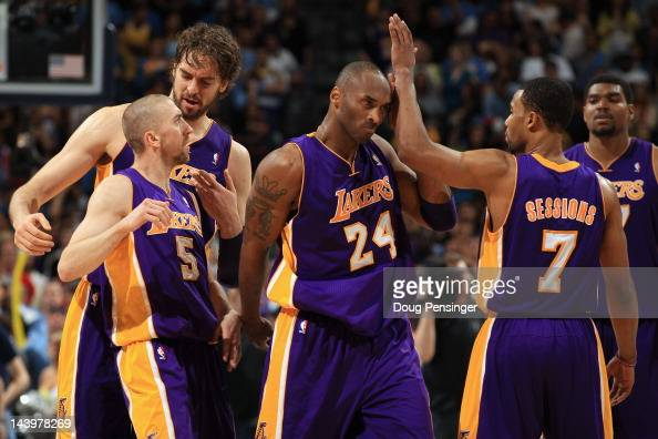 Steve Blake Pau Gasol Kobe Bryant Ramon Sessions and Andrew Bynum of the Los Angeles Lakers celebrate their victory over the Denver Nuggets in Game...