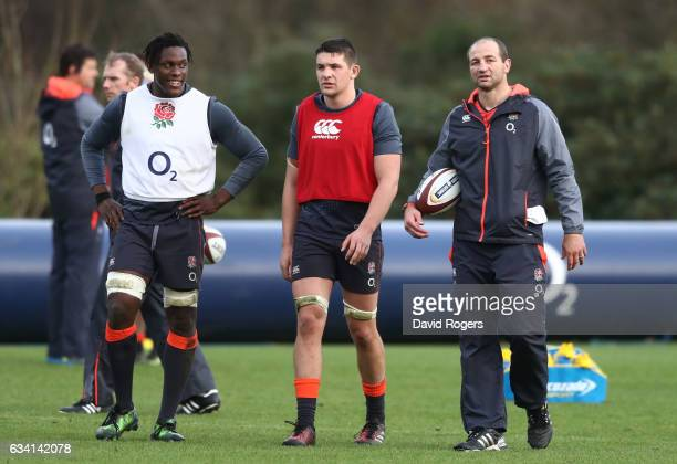 Steve Borthwick England Forward Coach looks on with Maro Itoje and Charlie Ewels during the England training session at Pennyhill Park on February 7...