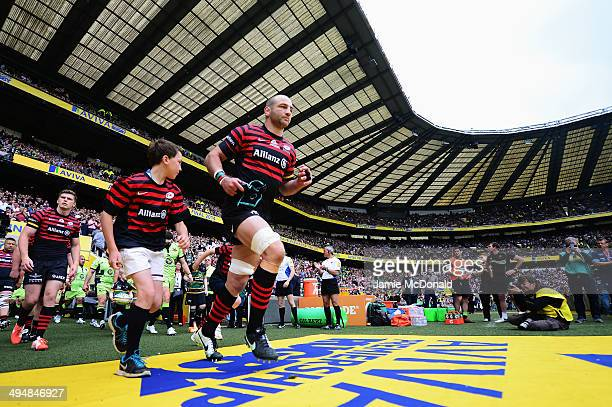 Steve Borthwick of Saracens leads out his side for the Aviva Premiership Final between Saracens and Northampton Saints at Twickenham Stadium on May...