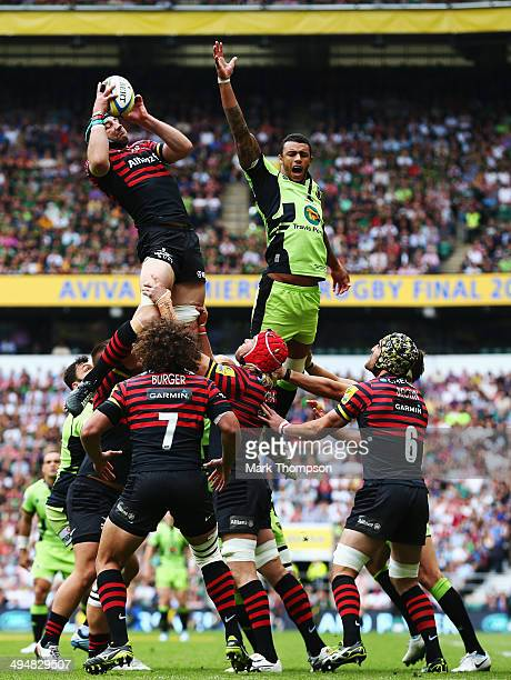 Steve Borthwick of Saracens retrieves the ball at a line out ahead of Courtney Lawes of Northampton Saints during the Aviva Premiership Final between...