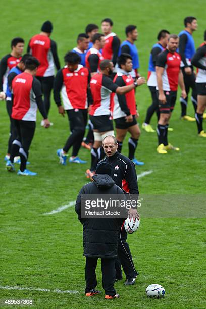 Steve Borthwick the Forwards Coach of Japan in conversation with Eddie Jones the Head Coach of Japan during the Captain's Run ahead of the Japan...