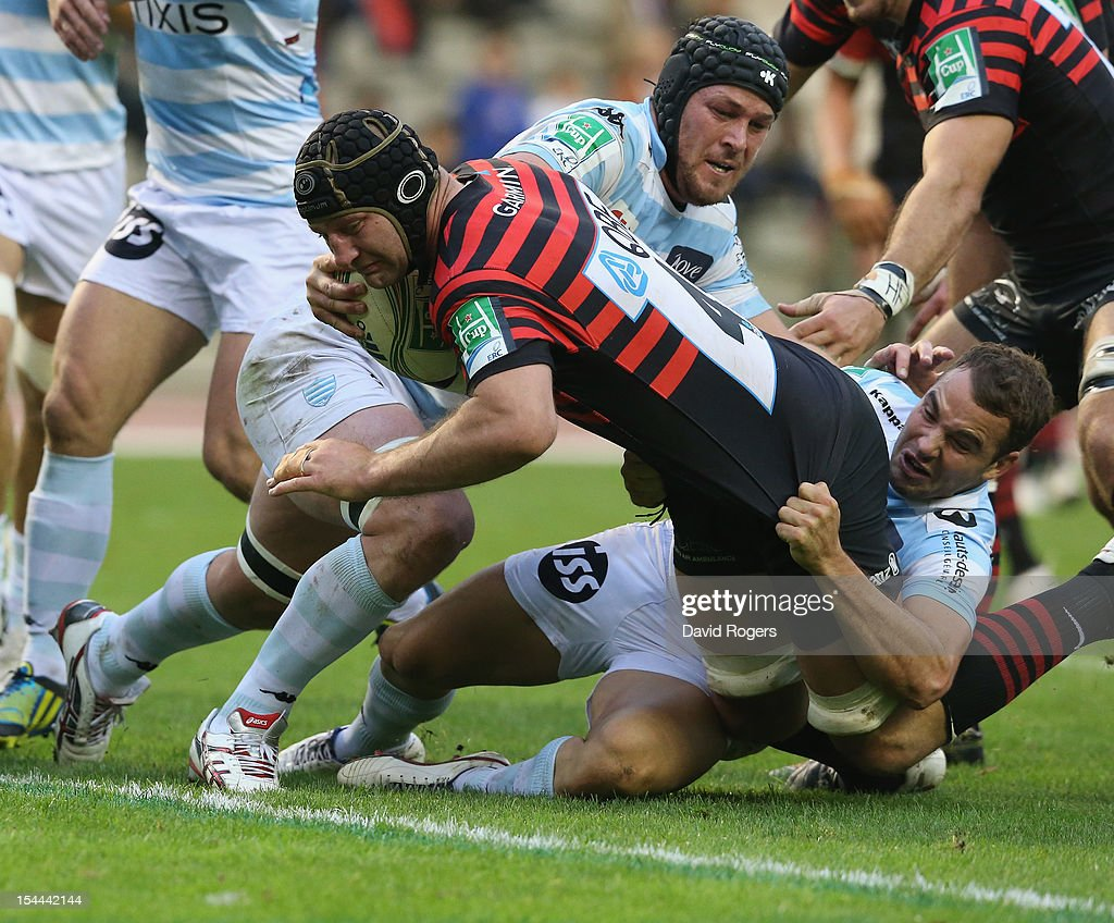 Steve Borthwick, the Saracens captain, dives over for a try despite being tackled by Olly Barkley (R) and Jacques Cronje during the Heineken Cup match between Saracens and Racing Metro at King Baudouin Stadium on October 20, 2012 in Brussels, Belgium.