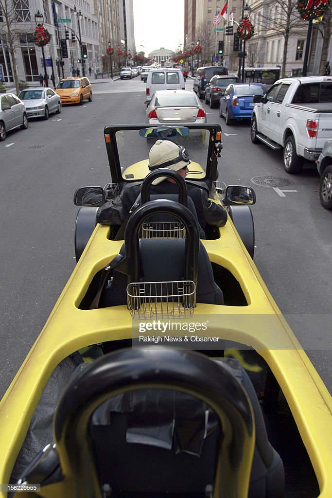 Steve Braithwaite drives his 23-foot banana-shaped vehicle through downtown Raleigh, North Carolina, Tuesday, December 11, 2012. Braithwaite and his brother are raising funds so they can drive around the world with the Big Banana Car to raise awareness of DVT, a blood clot that forms inside of the body. Their mother died due to DVT. For more information, visit www.bigbananacar.com.