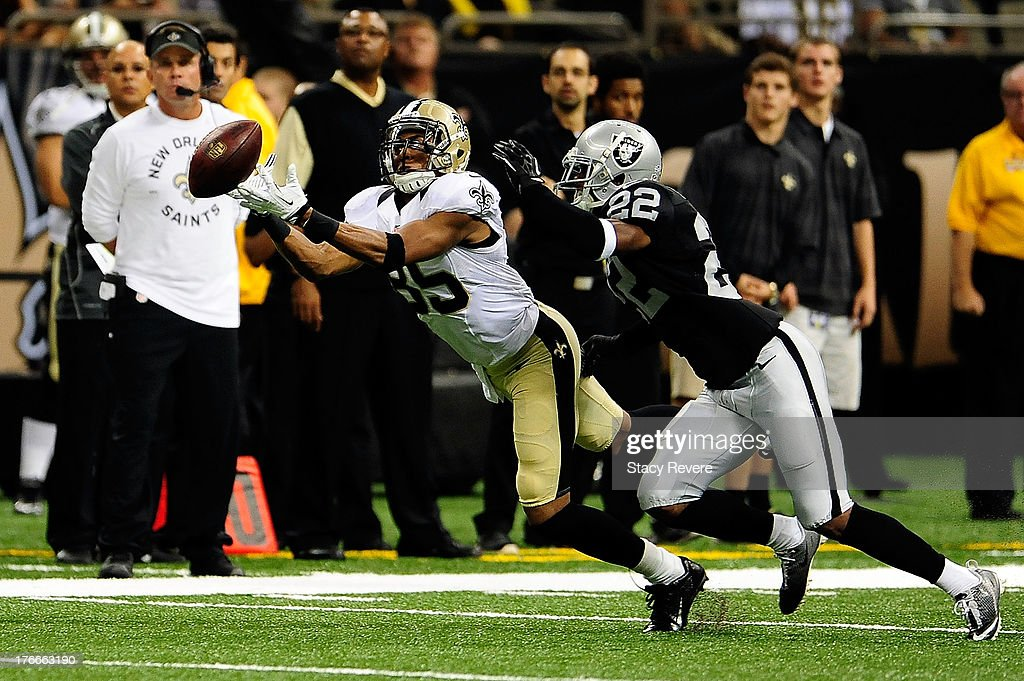 <a gi-track='captionPersonalityLinkClicked' href=/galleries/search?phrase=Steve+Breaston&family=editorial&specificpeople=220750 ng-click='$event.stopPropagation()'>Steve Breaston</a> #85 of the New Orleans Saints is unable to catch a pass in front of Taiwan Jones #22 of the Oakland Raiders during a preseason game at the Mercedes-Benz Superdome on August 16, 2013 in New Orleans, Louisiana.
