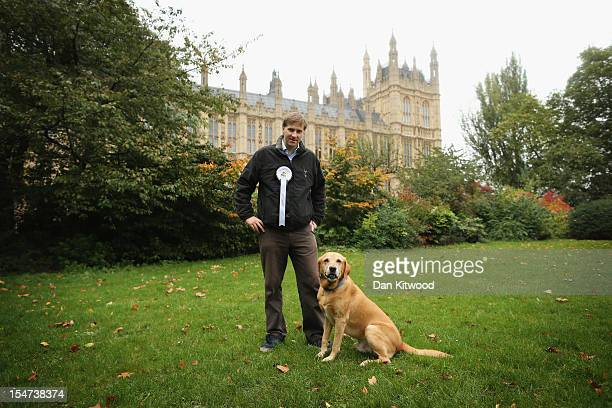 Steve Brine Conservative MP for Winchester stands in front of The Houses of Parliament with his dog Popcorn a Labrador during the Westminster Dog of...