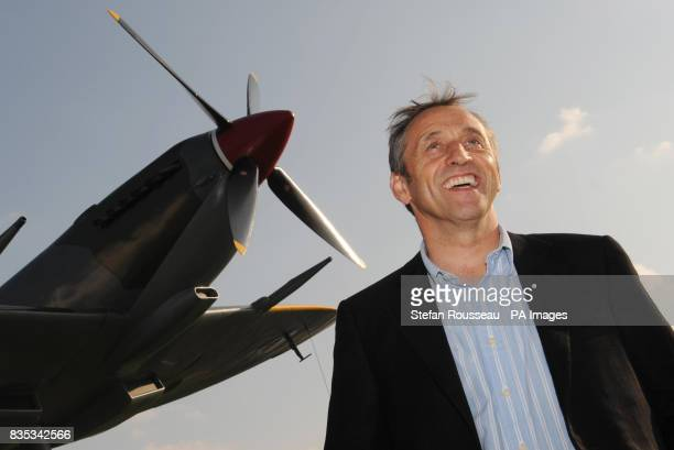 Steve Brooks stands next to a Spitfire similar to the one that he has just bought at auction for 178 million