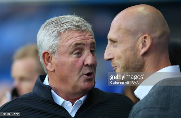 Steve Bruce manager of Aston Villa greets Jaap Stam manager of Reading before the Sky Bet Championship match between Reading and Aston Villa at...