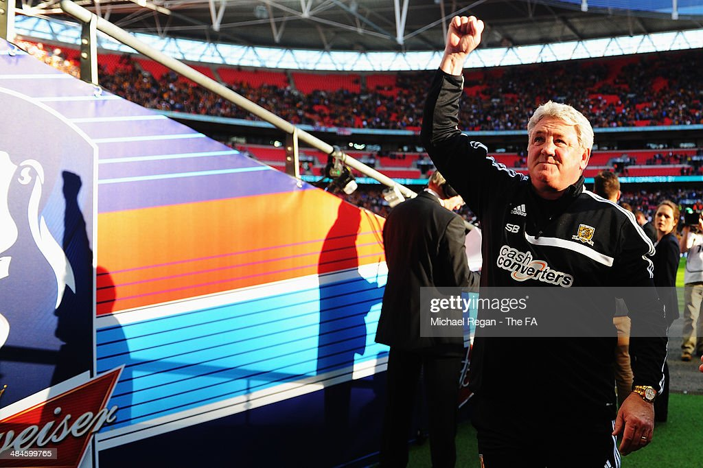 <a gi-track='captionPersonalityLinkClicked' href=/galleries/search?phrase=Steve+Bruce+-+Soccer+Manager&family=editorial&specificpeople=208832 ng-click='$event.stopPropagation()'>Steve Bruce</a>, manager of Hull City celebrates their victory after the FA Cup Semi-Final match between Hull City and Sheffield United at Wembley Stadium on April 13, 2014 in London, England.